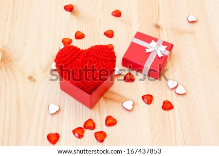 box with a cute red knitted valentine's heart