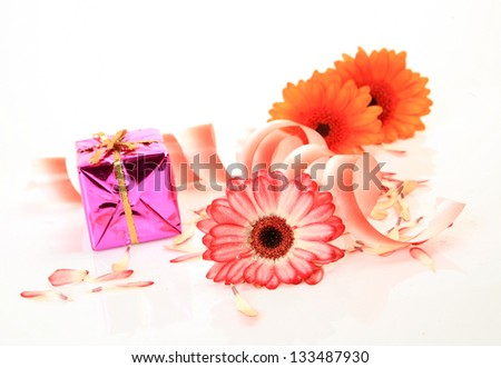 Box with a gift and flowers