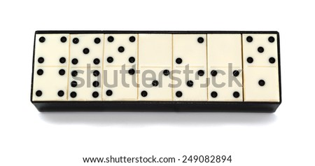 Box with dominoes on a white background - stock photo