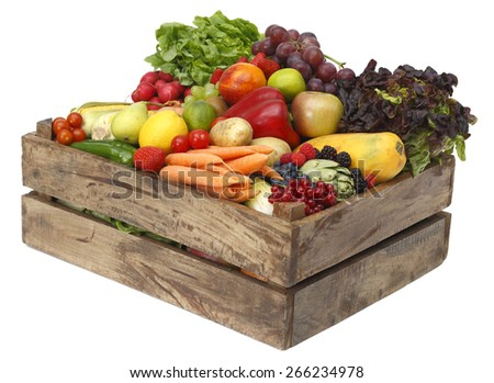 Box with fruits and vegetables on white background Assorted fruits in wooden box isolated on white background - stock photo