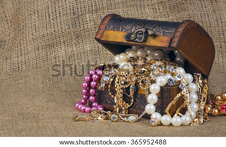 box with jewelry on sacking - stock photo
