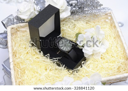 box with luxury watch on basket gift - stock photo