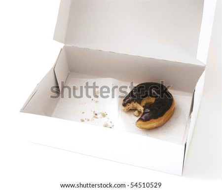Box with one partially eaten donut - stock photo
