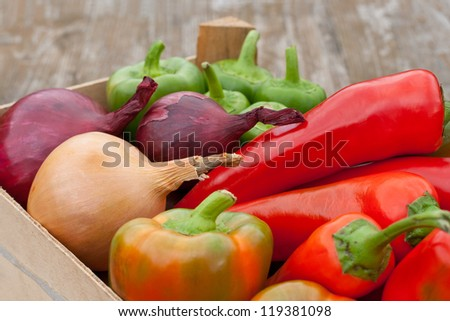 box with pepper and onions/vegetables/pepper