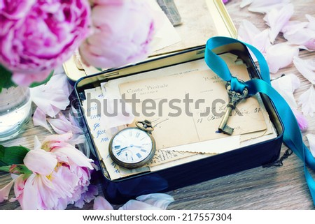 box with vintage mail, old key and antique clock - stock photo