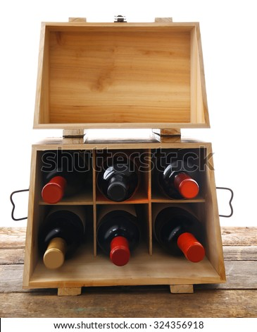 Box with wine bottles on the table - stock photo