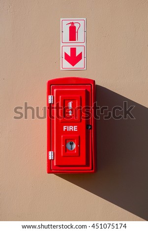 Box with with fire extinguisher inside and drop shadow on the wall