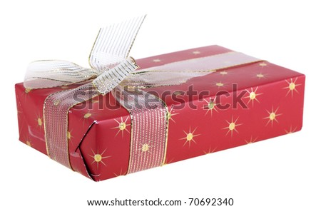 Box wrapped in a red paper and tied up by a gold tape with a bow, isolated on a white background - stock photo