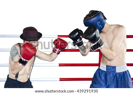 Boxer and his opponent during a box fight in a ring isolated on white background - stock photo