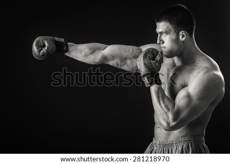 Boxer. Black and white stock photography. Man with boxing gloves on a black background. - stock photo