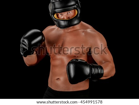 Boxer man face closed mask athletic body on black background