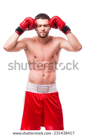 Boxer meditating before the fight
