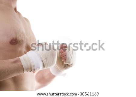 Boxer's knuckles taped up with bandage over white - stock photo