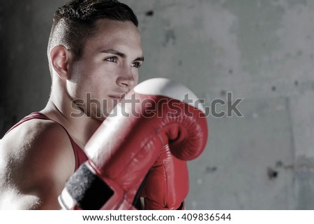 boxer standing next to an old wall and ready to fight - stock photo