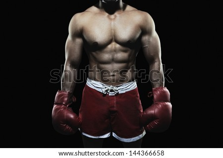 Boxer wearing a glove - stock photo