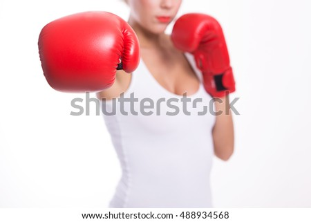 Boxer woman during boxing exercise making direct hit with red glove. Photo set of sporty muscular female brunette girl wearing sports clothes over white background isolated
