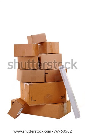 Boxes carelessly piled on top of each other over white background- no shadows. - stock photo