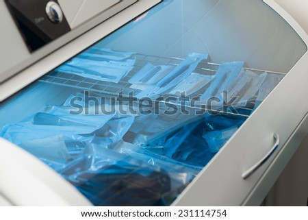Boxes for disinfection of dental instruments - stock photo