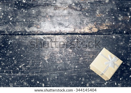 Boxes for gifts on old boards. Christmas background. Christmas decorations. New Year background. Xmax background. Holiday background. Toned image. Falling Snow . - stock photo