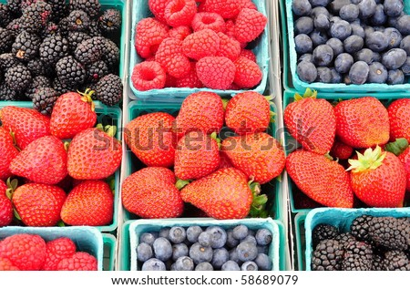 Boxes of berries at a farmers market. - stock photo