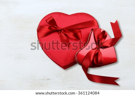 Boxes of chocolate against a wood background - stock photo