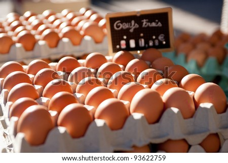 Boxes of farm eggs on a French market stall - stock photo