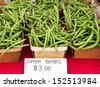 Boxes of fresh green beans at local market. - stock photo