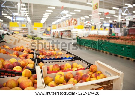 Boxes of peaches on the counter in the store. - stock photo