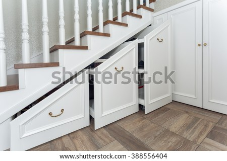 Boxes under a ladder - stock photo