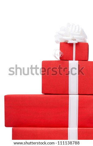Boxes with gifts wrapped in red paper and white bows, isolated on white - stock photo
