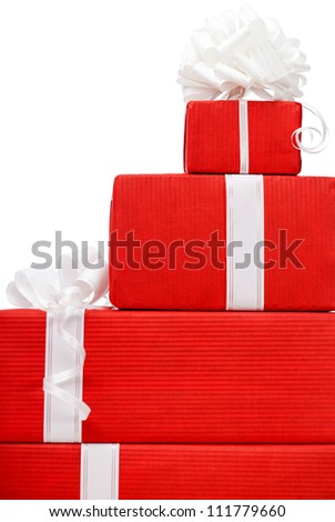 Boxes with new year's presents wrapped in red paper, isolated on white - stock photo