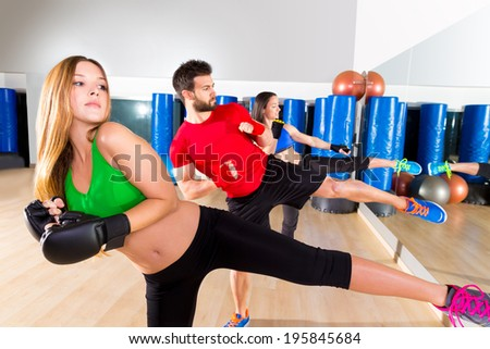 Boxing aerobox group low kick training at fitness gym mirror - stock photo