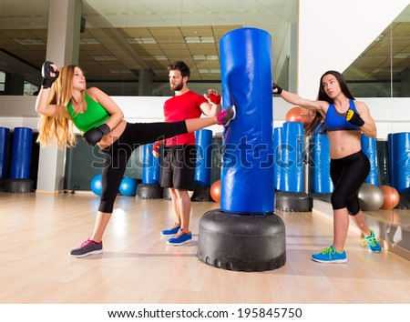 Boxing aerobox women group with personal trainer man at fitness gym - stock photo