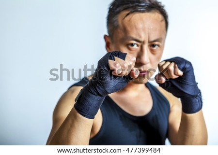 Boxing  asian men ready to fight.