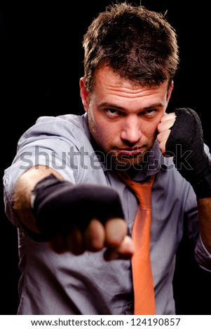 Boxing businessman throwing a jab