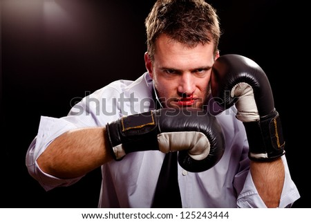 Boxing businessman throwing left hook. High contrast.