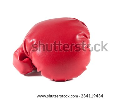 Boxing glove waiting for a fighter and a boxing match - stock photo