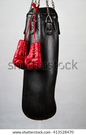 Boxing gloves and punching bag - stock photo