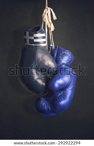 Boxing gloves as a symbol of EU vs. Greece - stock photo