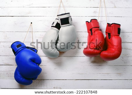 boxing gloves blue, white and red wall hung - stock photo