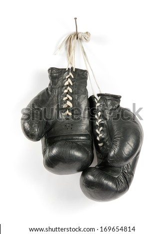 boxing gloves on a nail isolated  - stock photo