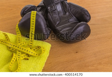 Boxing gloves on a wooden background - stock photo