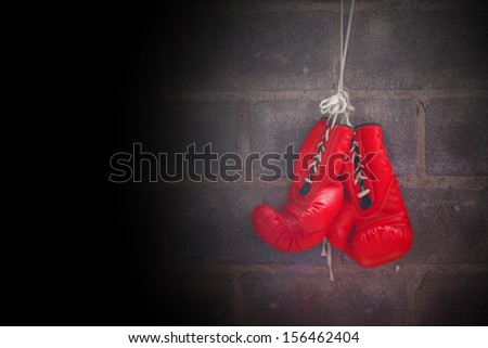 boxing gloves on the wall - stock photo