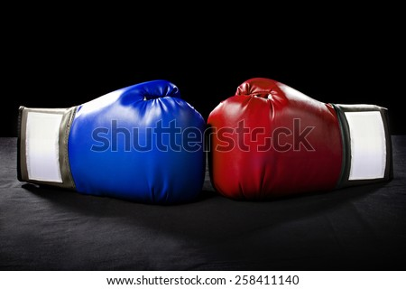 boxing gloves or martial arts gear on a black background - stock photo