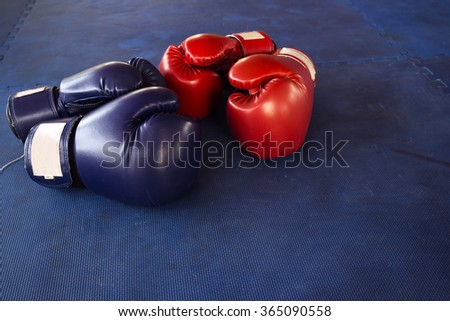 boxing gloves or martial arts gear on a Blue background - stock photo