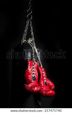 Boxing gloves series : Pair of red boxing gloves with low key lighting - stock photo
