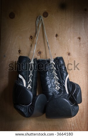 boxing gloves - well worn & hanging up - stock photo