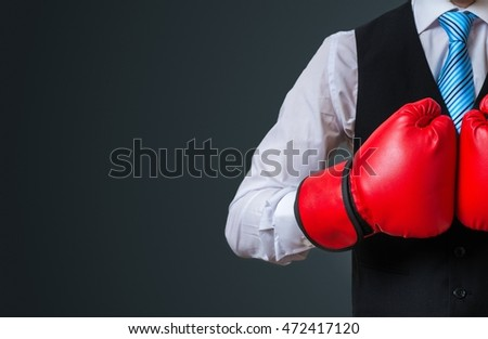 Boxing manager with red gloves on black background.