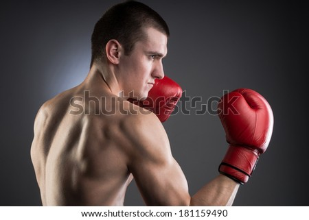 Boxing. Muscular fighter. Studio shot. - stock photo