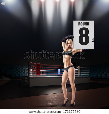 Boxing ring girl holding a board. High resolution - stock photo